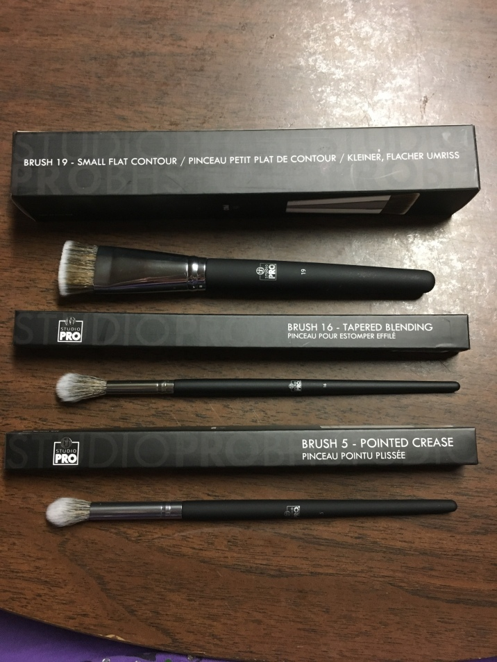 Brushes from top, #19 small flat contour, #16 tapered blending, and #5 pointed crease